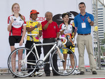 The Winner Yellow Jersey. KUALA LUMPUR, MALAYSIA-October 16: Tan Sri Datuk Nasruddin Bahar, awarding the prize to the winner at OCBC Cycle Malaysia 2011 in Kuala Stock Photos