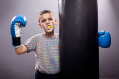 Winner,young child with boxing gloves Royalty Free Stock Images