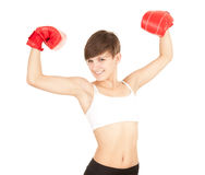 Winner young woman with boxing gloves Stock Photo