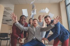 We are the winners. business people having fun while racing on office chairs Royalty Free Stock Image