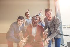 We are the winners. business people having fun while racing on office chairs Royalty Free Stock Photo