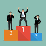 Winners businessman stand on a podium Stock Image