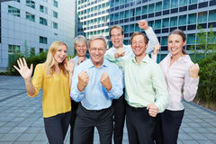 Winners cheering in business team. Winners cheering together with their clenched fists in a business team Royalty Free Stock Photography