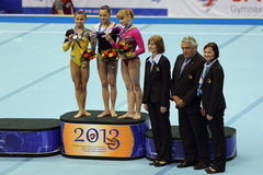 The winners of competition on a Balance Beam. MOSCOW - APR 21: 2013 European Artistic Gymnastics Championships. Awarding of winners Balance Beam -  Larisa Stock Photography