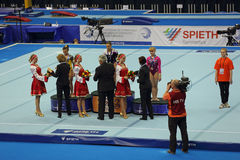 The winners of competition on a Balance Beam. MOSCOW - APR 21: 2013 European Artistic Gymnastics Championships. Awarding of winners Balance Beam - Larisa Royalty Free Stock Image