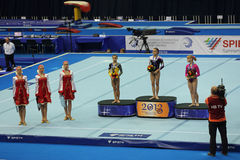 The winners of competition on a Balance Beam. MOSCOW - APR 21: 2013 European Artistic Gymnastics Championships. Awarding of winners Balance Beam - Larisa Stock Images
