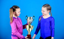 Winners in competition. victory of teen girls. Sport success. Acrobatics and gymnastics. Little girls hold jump rope. Happy children with gold champion cup. in royalty free stock photography