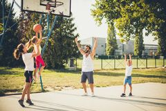 We are the winners. Family playing basketball together royalty free stock photography
