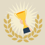 A winners hand with a golden cup royalty free illustration