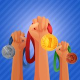 Winners hands holding medals Royalty Free Stock Images