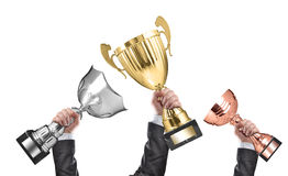 Winners. Holding champion golden, silver and bronze trophies royalty free stock photos