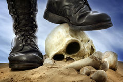 Winners and losers. Military shoes , skull and bones cruelty of war winners and losers unique concept stock photography