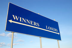 Winners and losers. Concept billboard and blue sky Royalty Free Stock Image
