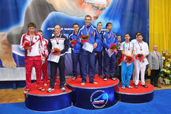 Winners of opened championship on swimming. MOSCOW - OCTOBER 5: Winners of opened championship of Russia on swimming 2010 on prize places in sporting complex Royalty Free Stock Photo