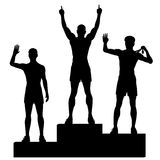 Winners podium. Editable vector silhouettes of three male athletes celebrating on a medal podium with each figure as a separate object Royalty Free Stock Images