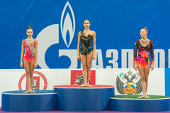 Winners on the podium. MOSCOW, RUSSIA - FEBRUARY 21, 2016: Winners on the podium before the award on Rhythmic gymnastics Alina Cup Grand Prix Moscow - 2016 in stock photos