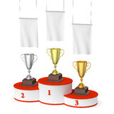 Winners podium with trophy cups and blank white flags, right top. Sports winning, competition and championship  success concept - winners trophy cups on round Royalty Free Stock Images