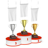 Winners podium with trophy cups and blank white flags. Sports winning, championship and competition success concept - winners trophy cups on round sports Royalty Free Stock Photos