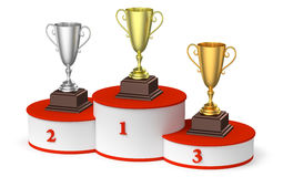 Winners podium with trophy cups diagonal view. Sports winning, championship and competition success concept - golden, silver and bronze winners trophy cups on Stock Image
