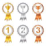 Winners Set 1 - Gold, Silver and Bronze Rosettes. Gold, Silver and Bronze rosette badges with trophy and place numbers for 1st, 2nd and 3rd Royalty Free Stock Photos