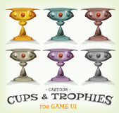 Winners Trophies And Cups For Game UI. Illustration of a set of funny cartoon gold award winner trophies, and prizes with different levels and categories, for Royalty Free Stock Photo