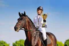 Winners - young girl and bay horse Stock Photo