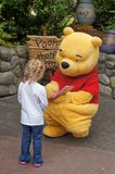 Winnie The Poo. At Disneyland signing an autograph for a little girl Stock Photography