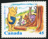 Winnie the Pooh. CANADA - CIRCA 1996: stamp printed by Canada, shows Milne and Shepard's Winnie the Pooh, 1926, circa 1996 Stock Photo
