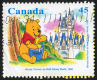 Winnie the Pooh. CANADA - CIRCA 1996: stamp printed by Canada, shows Winnie the Pooh at Walt Disney World, circa 1996 Stock Photo