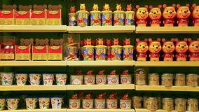 Winnie the pooh candy tins and cups. For sale at disneyland hong kong Stock Images