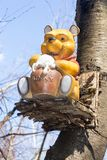 Winnie the Pooh Disney display figure. Winnie the Pooh is sitting on a tree eating its honey Stock Photos