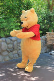 Winnie-the-Pooh at Disneyland. Anaheim, California, USA - May 30 , 2014: Pooh Bear, a main character from Winnie-the-Pooh fiction, is greeting, tourists at Stock Photo