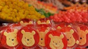 Winnie the Pooh färgade klubbor I Arkivbild