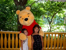 Winnie the Pooh. Hong Kong, Circa September 2010. Children posing with Disney's Winnie the Pooh at the Hong Kong Disney resort Stock Photo
