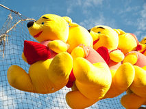 Winnie the pooh stuffed toys. Winnie the pooh stuffed toy bear prizes at a fair Stock Photos