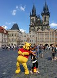 Winnie the Pooh and tourists in the Old Town Square, Prague