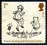 Winnie the Pooh UK Postage Stamp. GREAT BRITAIN - CIRCA 2010: A used postage stamp from the UK, depicting an illustration of Winnie the Pooh and Christopher Stock Image