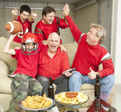 Winning. Football fans excited because their team is winning Stock Images