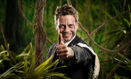 Winning adventurer businessman thumbs up Royalty Free Stock Images