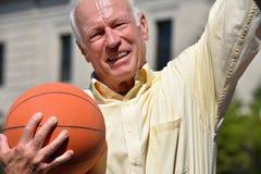 Winning Athlete Senior Male Basketball Coach. A retired senior adult male royalty free stock photos