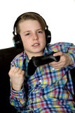 Winning attitude on facial expression of preteen boy playing. Winning attitude preteen boy playing video game Royalty Free Stock Photography