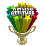 Winning Attitude Gold Trophy Stars Fireworks Good Vision. The words Winning Attitude in a gold trophy with colorful stars and fireworks shooting around it to Royalty Free Stock Photography
