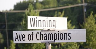 Winning Avenue of Champions. A street sign with the words winning and avenue of champions, these words are normally association with team sports, such as royalty free stock photos