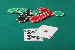Winning Black jack. Cards in a black jack game, Winning hand with betting chips on the table Royalty Free Stock Photography