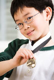 Winning boy with his medal. An asian boy showing his winning sport medal Royalty Free Stock Photos