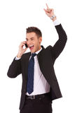 Winning business man on the phone Stock Photography