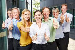 Winning business people team holding thumbs up Royalty Free Stock Photography