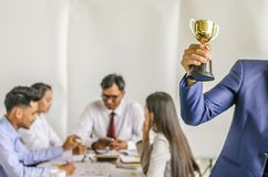 Winning business team gold trophy , business team happy consent Royalty Free Stock Images