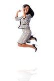 Winning business woman jumping cheering Stock Photo