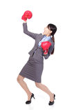 Winning business woman wearing boxing gloves stock photography